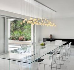 https://i.pinimg.com/236x/04/6a/58/046a58aeff8eb46f90ade3519ebb344b--contemporary-dining-rooms-contemporary-chandelier.jpg