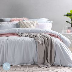 Add a unique flair to your bedroom décor with the Linen Cotton Pom Pom Quilt Cover Set! Available in a beautiful shade of light blue and natural, with a pom pom trim, this is a perfect choice for any season. #PillowTalk #ForTheLoveOfComfort #Bedroom #BedroomDecor #QuiltCover