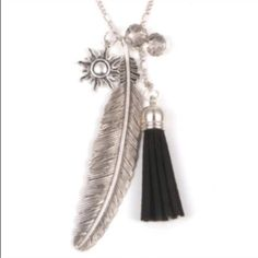 Feather Tassel Necklace✨LAST ONE✨ Beautiful zinc alloy Silvertone necklace. Black suede tassel and clear crystal balls. Chain is about 28 inches and I would say the feather charm is about 3 1/2 inches. This is big and pretty! New in package. Jewelry Necklaces