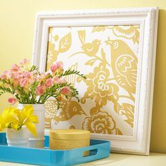 "Old Frame Spray painted+fabric-covered board+tray with accents=(very creative ""design on a dime"" display)"