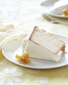 """Lemony Angel Food Cake Recipe topped with citrus cream frosting and candied lemon """"daffodils."""""""