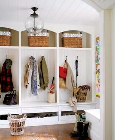 Love this super stylish mudroom by Sue. Cubbies + hooks + drawers = organized bliss.The light fixture is my fave.