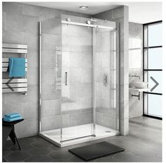 Large wall tiles & 2 glass walls 2 tiled walls allows more light in to room.