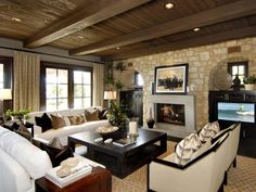 Design Ideas: Wall Stone Living Room With Wood Panel Ceiling. ceiling design. timber ceiling. beams exposed ceiling. stone wall living room. dark coffee table. white sofa. shelf top fireplace. floor to ceiling drapery. potted plants.