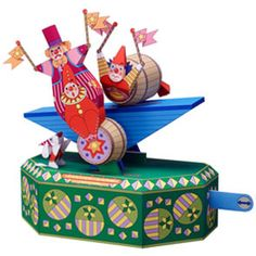 "Free paper craft from Canon. Download and print. With the ""Acrobat of clown-in-a-barrel"", when you push and pull the lever on the right, the barrels on the seesaw roll back and forth, and the eyes of the clowns inside the barrels also roll."