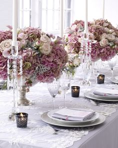 Romantic pink, ivory and antique rose centerpieces in antique silver compotes, on wedding veil lace runner {Evantine Design, TheKnot.com photo shoot}