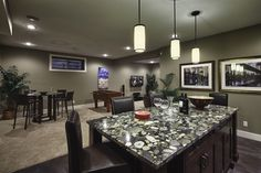 Developed Basement - wet bar with upgraded granite and combined TV area and games room