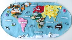 Montessori Wall Map & Quietbook with Printables - this is an amazing resource with free printables of animal 3-part cards for all of the continents and oceans. #safari ltd #geography #biology