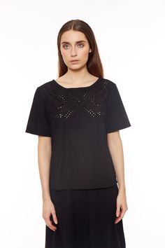Hand embroidered black top in 100% cotton. Short sleeves with hand embroidered cut out detail. Length 63cm.