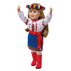 Ukrainian Dance Outfit. This costume has embroidery an traditional blouse, shirt has an uderskirt with rick rack trim, red boots and a sash belt.