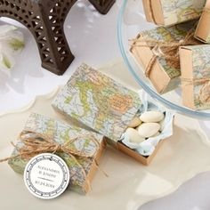 """Around the World"" map favor boxes are the perfect wedding accessory for the travel enthusiast couple."