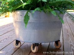 This would be a cute rolling toy bin for Connor's porch toys...love the wooden casters from Rockler.  Repurpose a Galvanized Tub into a Modern Rolling Container - bystephanielynn