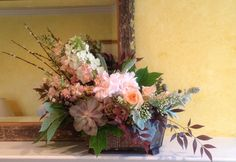 Peach, brown and gray neutral color palette with succulents, stock, roses, brunia berries, scabiosa pods, nandina, pussy willow, oak leaf hydrangea, dusty miller  and peonies by Fleur de Vie.
