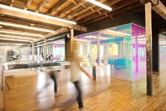 Leeser Architecture transformed Genius' new Gowanus office from a dusty industrial warehouse into a radiant, geometric light-refracting workspace.