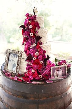 white wedding cake with cascading fuchsia, pink and purple roses, echinacea and calla lilies. vintage cake topper from the 50's. Orfila vineyards wedding // Temecula, California