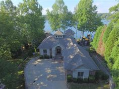 Paradise on Lake Norman can be yours in this well-maintained 4-bedroom4.5-bath waterfront home in the gated community of Astoria. One of a kind custom built home on 1.32 acre point lot on the main channel with over 550 of shoreline and a park like feel Waterfront walking trail Main floor owners suite and luxury bath. Large deck off the back and a covered lower patio. 3rd floor office with amazing views from the terrace. Dont be left in the dark this home has a Generac generator. Your…