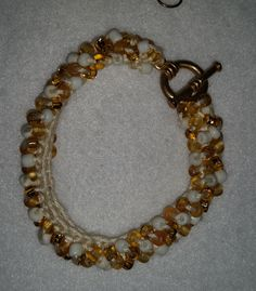 Crocheted Bead Bracelet Kit The kit includes white and gold 6/0 Czech glass beads, DMC embroidery floss, beading needle, a crochet hook, gold-tone toggle clasp and earring fish hooks.  http://meandercanyoncrafts.blogspot.com