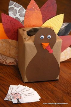Thanksgiving Kleenex Box Turkey Kids' Craft with Printable. Everyone writes down things they are thankful for and put it in the turkey box to be read at Thanksgiving dinner. Meaningfulmama.com
