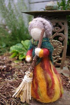 passengers on a little spaceship: old woman autumn, la befana and a needle felted doll