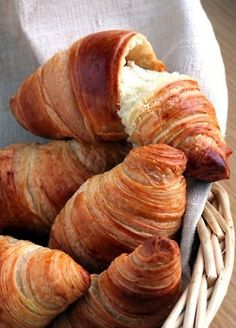 Eat a croissant at a bakery in Paris
