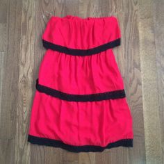 Red tiered dress! Size small! NWT Never worn. Has tags. Looks pink in picture but is red and black. Not anthropologie brand! Anthropologie Dresses Mini