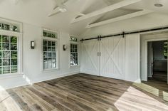 Farmhouse Renovation - floors and barn door on white