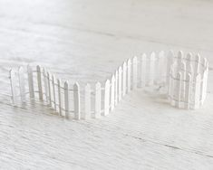 Fairy Garden Fence - Miniature White Picket Fence An adorable miniature white picket fence for your fairy garden. This makes great edging around a flower pot or crafted scene. The fence is made of pai