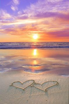 ♥♥ love on the beach at sunset Two heart shapes on beach with sunset and reflections in the water.