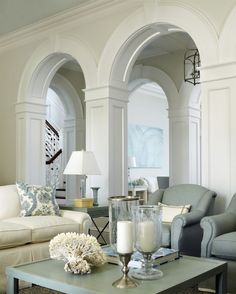 Inside, an arched colonnade dressed in gleaming white woodwork separates the family room from the living room. Extensive interior millwork is a hallmark of British Colonial style. House Design, Home And Living, Decor, Interior Design, House Interior, House, Home, Interior, Family Room