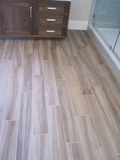 Love this floor.  Tile that looks like wood! Perfect for bathrooms.