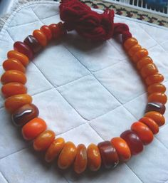 This is a traditional strand of Berber amber beads. To be worn as is or used as jewelry supply.  The beads vary in size from about 3/4 Inch to 1