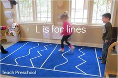 Learning about the sound of the letter L was a fun experience as we played games on lines taped to the carpet and traced lines on the light table...    The children arrived at preschool one morning to find lines taped to our