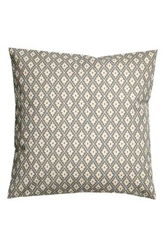 Patterned cushion cover: Cushion cover in a patterned cotton weave with a concealed zip.