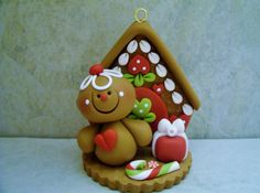 A little gingerbread man and his gingerbread house!  This is an original design that was handcrafted from polymer clay. The ornament measures approximately 2 1/2 tall and will hang from a jute hanger. All parts have been secured with liquid polymer for increased strength.    Not a toy...not suitable for young children.