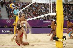 Misty May-Treanor (C) of the U.S. tries to save a point during their women's beach volleyball semifinal match