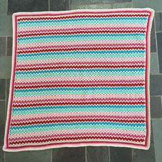 I have been wanting to make a granny and v-stitch blanket for a while so...here it is! This is baby blanket that I came up with for ...
