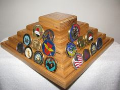 Military Challenge Coin Rack Holder Stand W/Lazy Susan. Challenge Coin Display, great for displaying your coins for every one to see. Mounted on a lazy susan for the ability to rotate display. Hold approximately 60 to 80 coins. I am a Desert Storm, Iraq and Afghanistan Veteran and enjoy making them for other Vets. They are mitered and spline joined made from Oak with splines of Black Walnut. Check my Facebook page, just search Augie's Woodcrafts on Facebook and see some thing I have made.