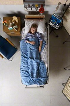 Girl in Hospital Bed. Possible signature image for safer surgery