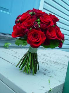 Black Magic roses, Black Beauty sweetheart roses, hypericum berries in a handtied bouquet.