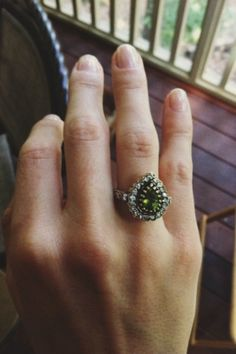 Pear-shaped green peridot ring