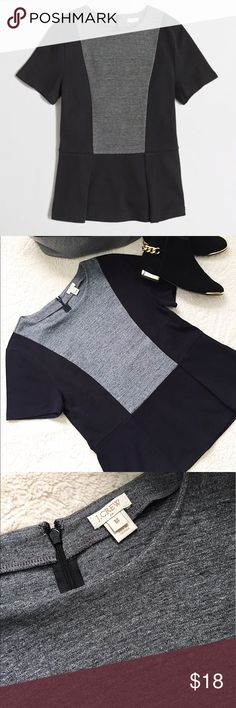 J. Crew Colorblock Peplum Top Sleek and sophisticated Peplum Top. Perfect for the office or paired with some dark skinnies and pumps. Soft cotton with some very minor fading and a hidden zip back closure. J. Crew Tops