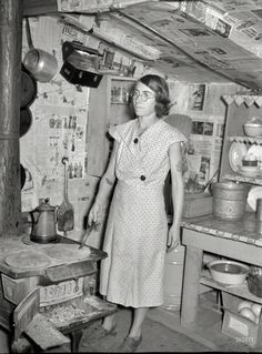 January 1939. Mother of family on relief living in shanty at city dump.