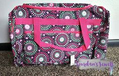 Swirl Dot Colorful Polka Dot Duffle bag. Pink, green, white, black polka dots. Seriously SO cute! Perfect for a weekend getaway, a quick business trip, a carry-on bag for your next flight or just a sleepover with some good company! Get it now at Jourdan's Jewels for just $20. And don't forget the matching cosmetic bag!