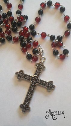 Red and black glass rosary. $20.00