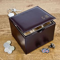 Personalised Monogram Leather Watch and Cufflink Box - Perfect Birthday Present, Christmas Gift , Fathers Day Gift idea,  for husband, Dad, Grandad, Godfather Dark brown bonded leather watch and cufflink box.     Set comes including hair and body wash, moisturiser, nail brush and flannel.     May be personalised with a choice of monogram stylesCan hold up to two watches and numerous pairs of cufflinks
