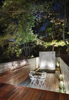 part of an infill house, 13 ft wide city garden, outdoor lighting, by  DMArchitects, Toronto