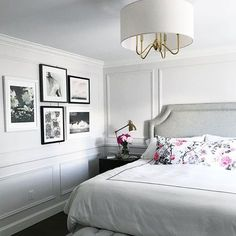 Vanessa Francis Design. Bedroom with moulding. Art wall. Upholstered headboard.