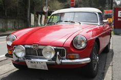 MGB with cool driving lights. I keep meaning to put my lights on my car.