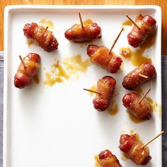 Basic smokies are even better with #bacon. (Isn't everything?) More #holiday recipes: http://www.bhg.com/thanksgiving/sides-appetizers/make-ahead-thanksgiving-appetizers/?socsrc=bhgpin111412baconsmokies#page=3
