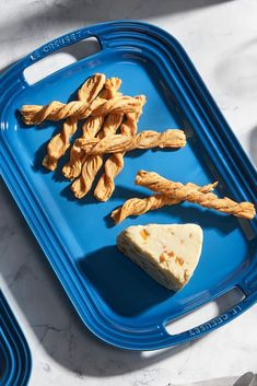 Our Baked Cheese Straws can be baked and served all on the same oven-safe platter — and they're a fun, easy recipe to make with your kids. Whether you serve them as an afternoon snack for the family or as part of a grown-up charcuterie board, this crunchy, cheesy recipe is a delicious, simple favorite. Cheese Straws, Baked Cheese, Cheesy Recipes, Charcuterie Board, Afternoon Snacks, Cooking With Kids, Diy Food, Platter, Food To Make